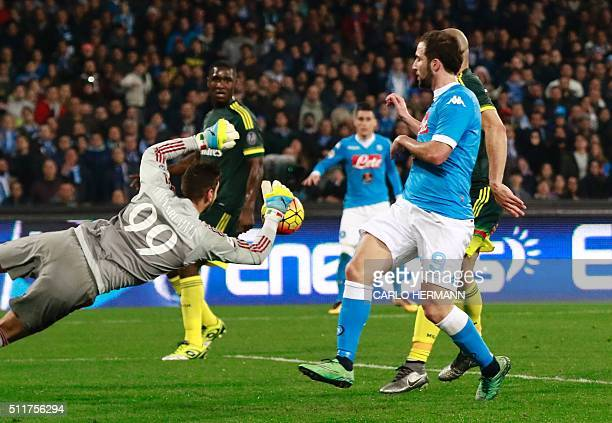 AC Milan's Italian goalkeeper Gianluigi Donnarumma stops the ball during the Italian Serie A football match SSC Napoli vs AC Milan on February 22...