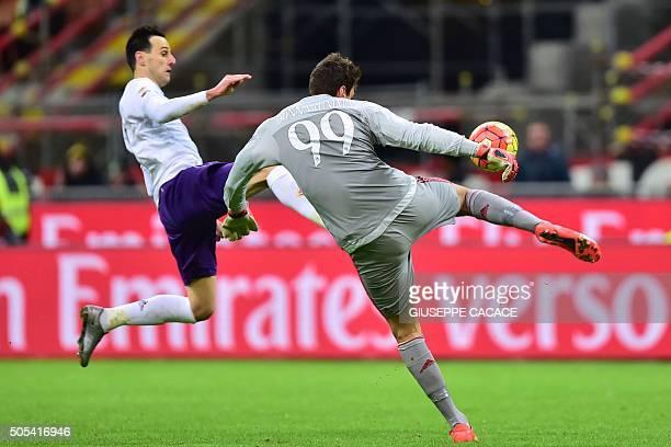 AC Milan's Italian goalkeeper Gianluigi Donnarumma vies for the ball for the ball with Fiorentina's Croatian forward Nikola Kalinic during the Serie...