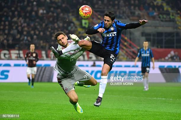 AC Milan's Italian goalkeeper Gianluigi Donnarumma vies with with Inter Milan's Brazilian forward Eder during the Italian Serie A football match...