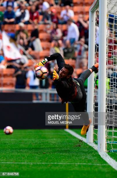 AC Milan's Italian goalkeeper Gianluigi Donnarumma warms up prior the Italian Serie A football match AC Milan vs Empoli at the San Siro stadium in...