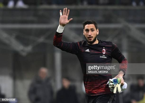 AC Milan's Italian goalkeeper Gianluigi Donnarumma waves prior to the Italian Serie A football match between AC Milan and Fiorentina at Giuseppe...