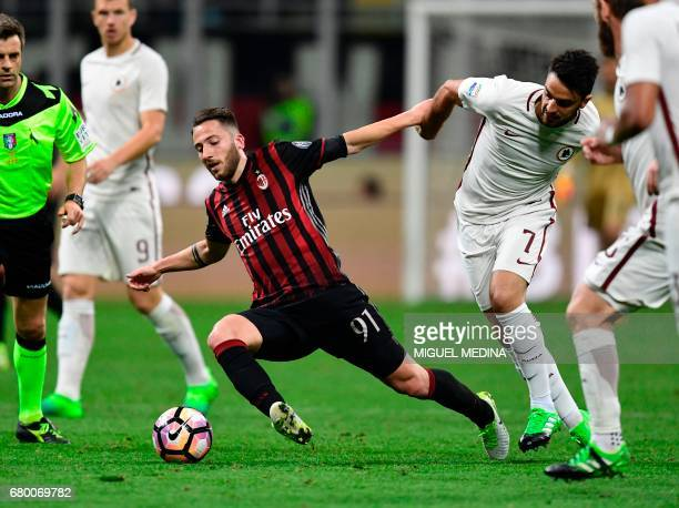 AC Milan's Italian midfielder Andrea Bertolacci vies with AS Roma's French midfielder Clement Grenier during the Italian Serie A football match AC...