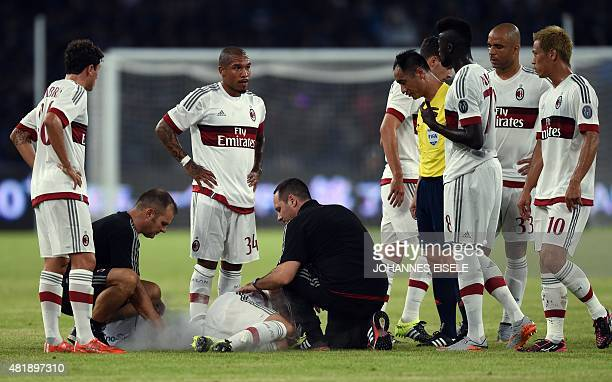 AC Milan's Italian midfielder Andrea Poli receives treatment after falling during the International Champions Cup football match between AC Milan and...