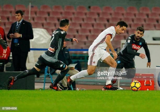 Milan's Italian midfielder Giacomo Bonaventura fights for the ball with Napoli's Albanian defender Elseid Hysaj and Napoli's Spanish striker Jose...