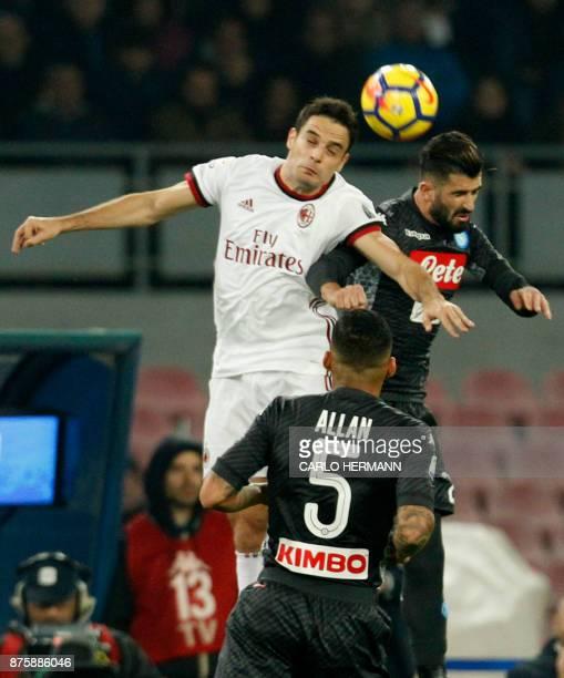 Milan's Italian midfielder Giacomo Bonaventura heads the ball next to Napoli's Albanian defender Elseid Hysaj during the Italian Serie A football...
