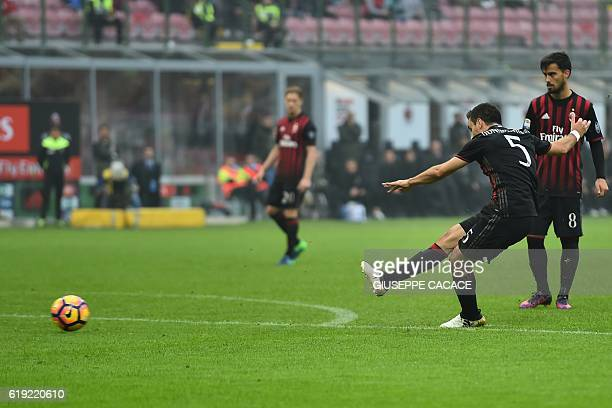 AC Milan's Italian midfielder Giacomo Bonaventura kicks the ball to score a goal during the Italian Serie A football match between AC Milan and...