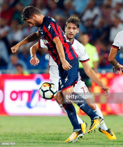 AC Milan's Italian midfielder Manuel Locatelli vies for the ball with Crotone's Swedish midfielder Marcus Rohden during the Italian Serie A football...
