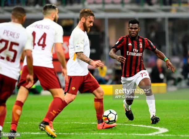 AC Milan's Ivoirian midfielder Frank Kessie' kicks the ball during the Italian Serie A football match AC Milan vs AS Roma at the San Siro stadium in...