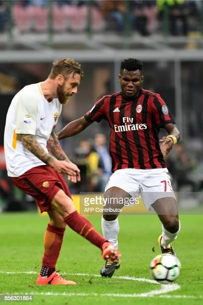 AC Milan's Ivoirian midfielder Frank Kessie' vies with AS Roma's Italian midfielder Daniele de Rossi during the Italian Serie A football match AC...