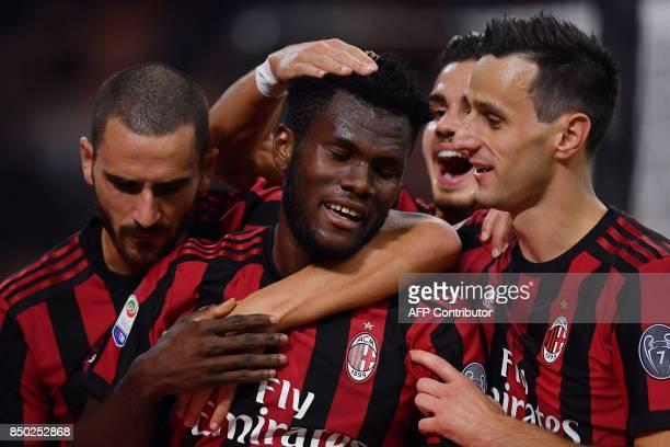 AC Milan's Ivorian midfielder Franck Kessie celebrates after scoring during the Italian Serie A football match AC Milan vs Spal at San Siro stadium...