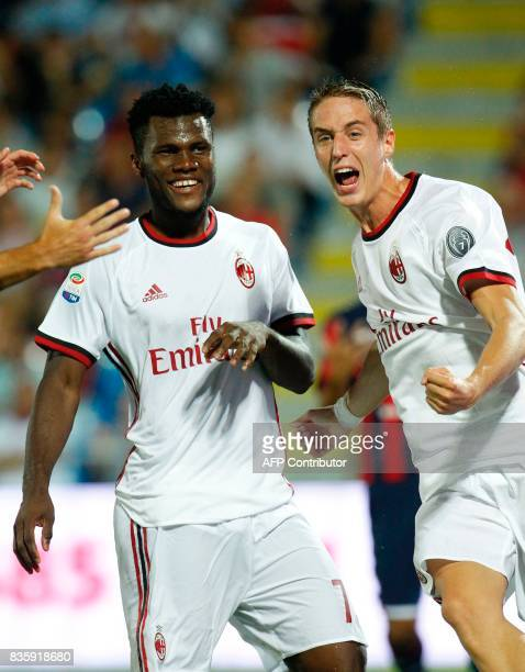 Milan's Ivorian midfielder Franck Kessie celebrates with teammate Milan's Italian defender Andrea Conti after scoring a goal during the Italian Serie...