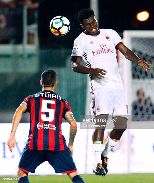 Milan's Ivorian midfielder Franck Kessie heads the ball in front of Crotone's Romanian forward Adrian Stoian during the Italian Serie A football...