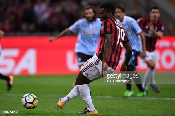 AC Milan's Ivorian midfielder Franck Kessie scores a penalty during the Italian Serie A football match AC Milan vs Spal at San Siro stadium in Milan...