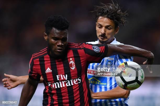 AC Milan's Ivorian midfielder Franck Kessie vies with Spal's Brazilian defender Felipe during the Italian Serie A football match AC Milan vs Spal at...