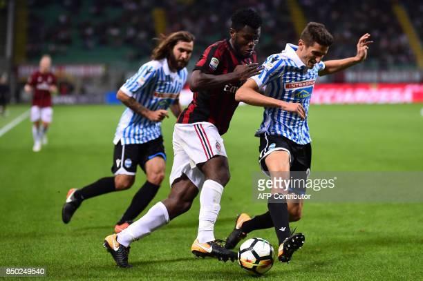 AC Milan's Ivorian midfielder Franck Kessie vies with Spal's Italian defender Federico Mattiello during the Italian Serie A football match AC Milan...