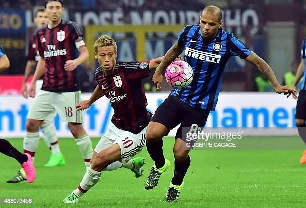 AC Milan's Japanese midfielder Keisuke Honda challenges Inter Milan's Brazilian midfielder Felipe Melo during the Serie A football match between...
