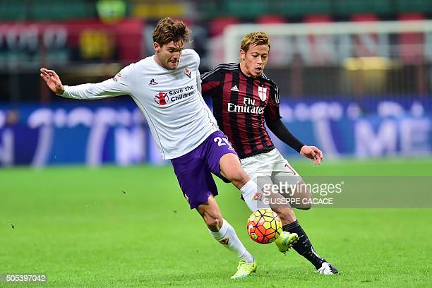 AC Milan's Japanese midfielder Keisuke Honda vies with Fiorentina's Spanish defender Marcos Alonso Mendoza during the Serie A football match between...