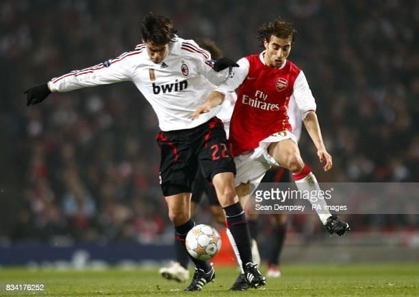 AC Milan's Kaka and Arsenal's Mathieu Flamini battle for the ball