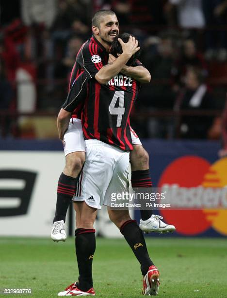 AC Milan's Kakha Kaladze and Gennaro Gattuso celebrate at the final whistle after reaching the UEFA Champions League Final