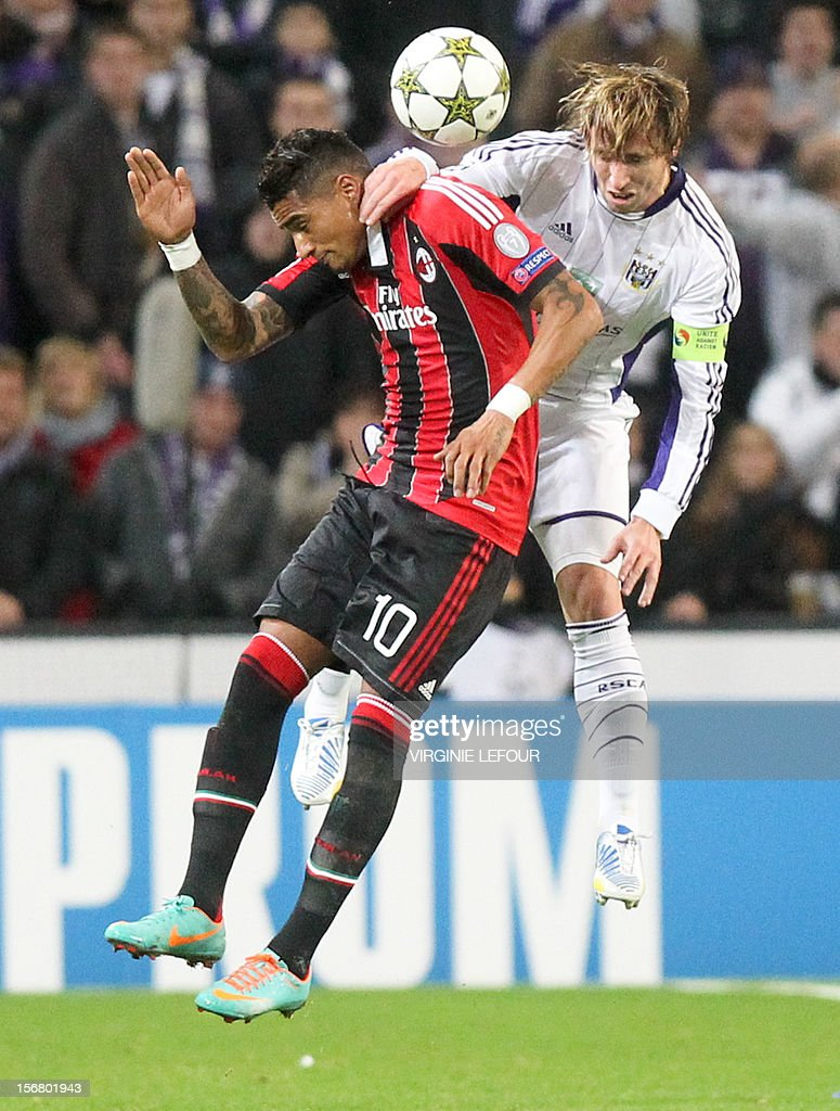 Milan's Kevin-Prince Boateng and Anderlecht's Lucas Biglia fight for the ball during the football game between RSC Anderlecht and AC Milan, on the fifth day of the group C of Champions League group C on November 21, 2012 in Brussels. LEFOUR