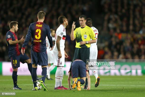 AC Milan's KevinPrince Boateng is booked by referee Viktor Kassai