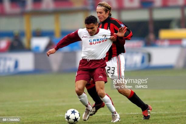 AC Milan's Massimo Ambrosini and Reggina's Julio Leon battle for the ball