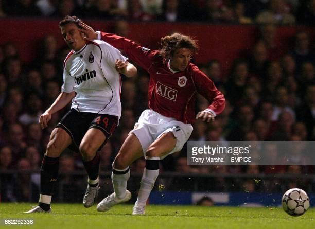 AC Milan's Massimo Oddo and Manchester United's Gabriel Heinze battle for the ball