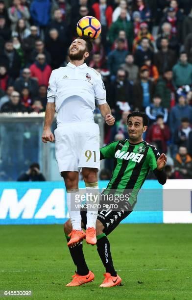 AC Milan's midfielder Andrea Bertolacci jumps for the ball next to Sassuolo's midfielder Alberto Aquilani during the Italian Serie A football match...
