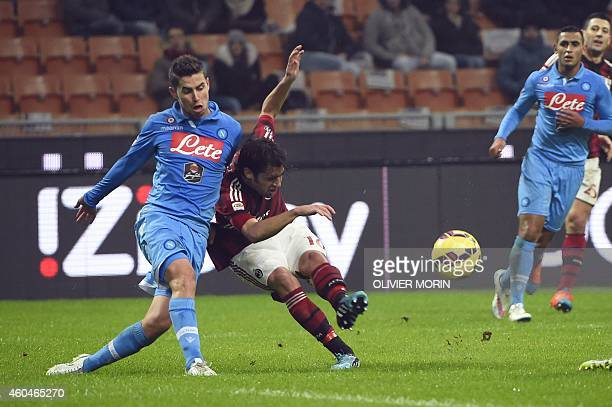 AC Milan's midfielder Andrea Poli fights for he ball with Napoli's forward from Belgium Dries Mertens during the Italian Serie A football match AC...