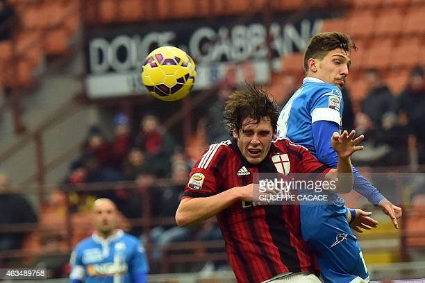 AC Milan's midfielder Andrea Poli fights for the ball with Empoli's midfielder Simone Verdi during the Italian Serie A football match between AC...