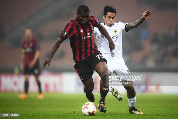 AC Milan's midfielder Franck Kessie from Ivory Coast fights for the ball with AEK's defender Rodrigo Galo Bito from Brazil during the UEFA Europa...
