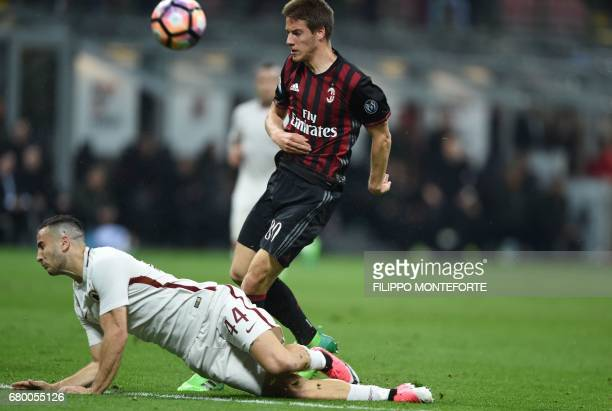 AC Milan's midfielder from Croatia Mario Pasalic vies with AS Roma's defender from Greece Kostas Manolas during the Italian Serie A football match AC...