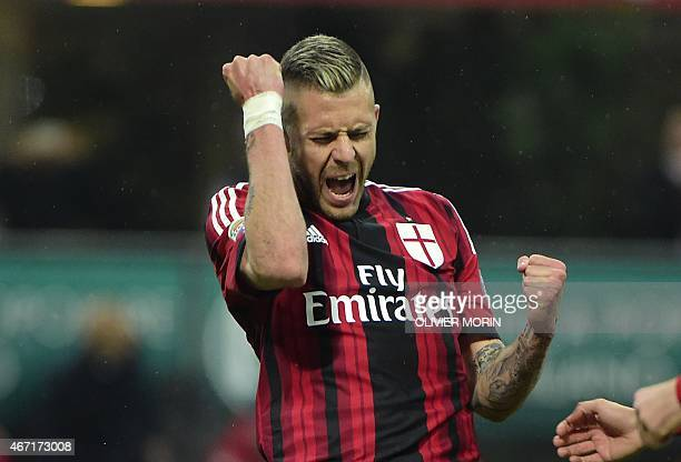 AC Milan's midfielder from France Jeremy Menez celebrates after scoring a penalty kick during the Italian Serie A football match AC Milan vs Cagliari...