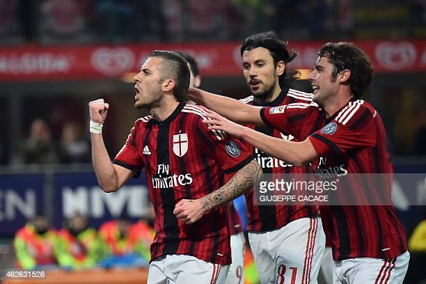 AC Milan's midfielder from France Jeremy Menez celebrates with teammates AC Milan's defender Cristian Zaccardo and AC Milan's midfielder Andrea Poli...