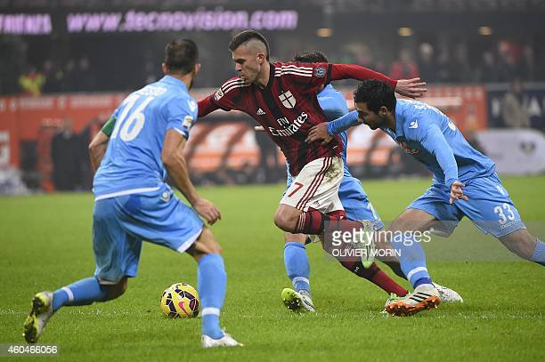 AC Milan's midfielder from France Jeremy Menez fights for the ball with Napoli's defender from Spain Raul Albiol during the Italian Serie A football...