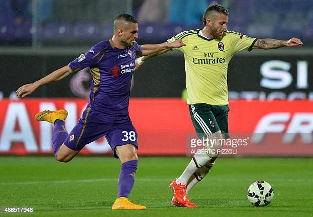 AC Milan's midfielder from France Jeremy Menez fights for the ball with Fiorentina midfielder Alessandero Rosi during the Italian Serie A football...