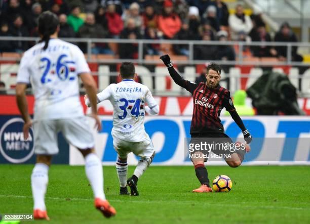 AC Milan's midfielder from Italy Andrea Bertolacci kicks the ball during the Italian Serie A football match AC Milan vs Sampdoria at 'San Siro'...