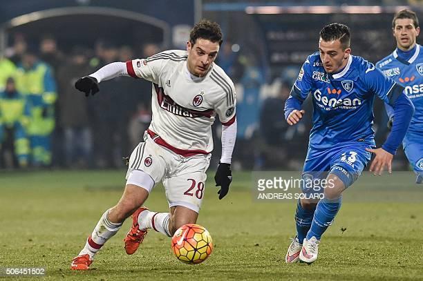 AC Milan's midfielder from Italy Giacomo Bonaventura fights for the ball with Empoli's midfielder from Italy Raffaele Maiello during their Italian...