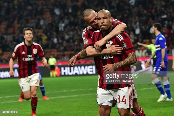 AC Milan's midfielder from Netherlands Nigel de Jong celebrates with AC Milan's defender Luca Antonelli after scoring during the Italian Serie A...