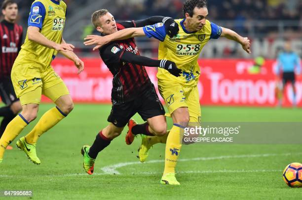 AC Milan's midfielder from Spain Gerard Deulofeu fights for the ball with Chievo's defender from Italy Dario Dainelli during the Italian Serie A...