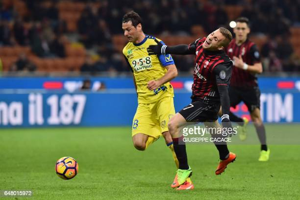 AC Milan's midfielder from Spain Gerard Deulofeu fights for the ball with Chievo's defender from Italy Massimo Gobbi during the Italian Serie A...