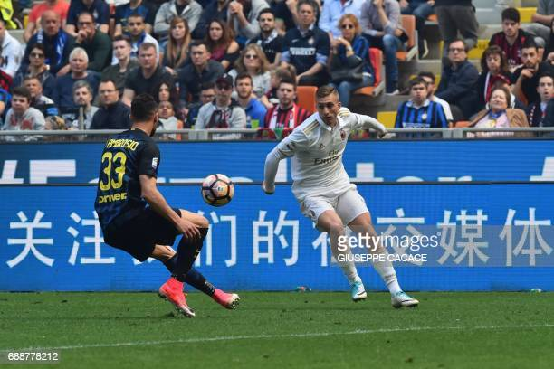 AC Milan's midfielder from Spain Gerard Deulofeu fights for the ball with Inter Milan's defender from Italy Danilo D'Ambrosio during the Italian...