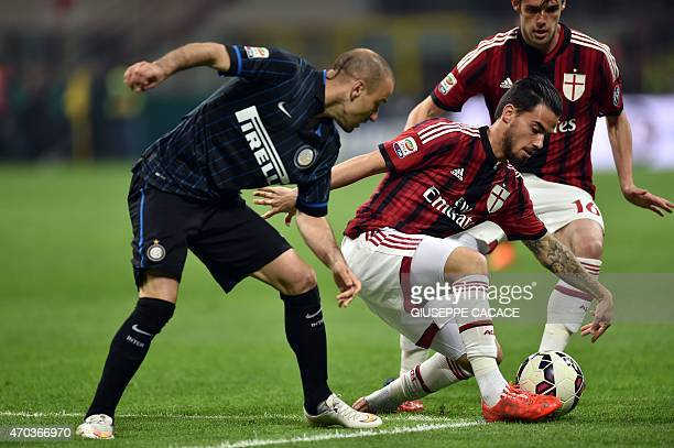 AC Milan's midfielder from Spain Suso fights for the ball with Inter Milan's forward from Argentina Rodrigo Palacio during the Italian Serie A...