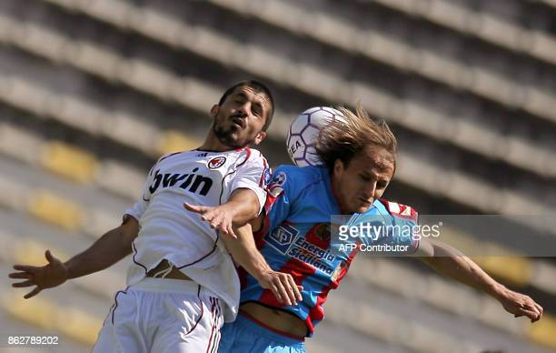 AC Milan's midfielder Gennaro Gattuso fights for the ball with Catania's midfielder David Baiocco during their Italian serie A football match at...