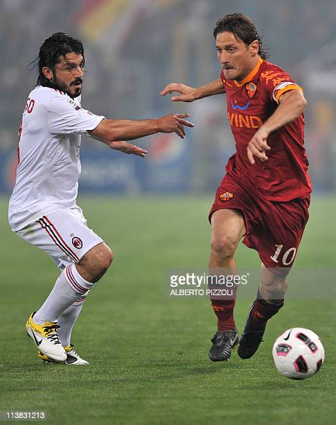 AC Milan's midfielder Gennaro Ivan Gattuso fights for the ball with AS Roma's forward Francesco Totti during their Italian serie A football match Aat...