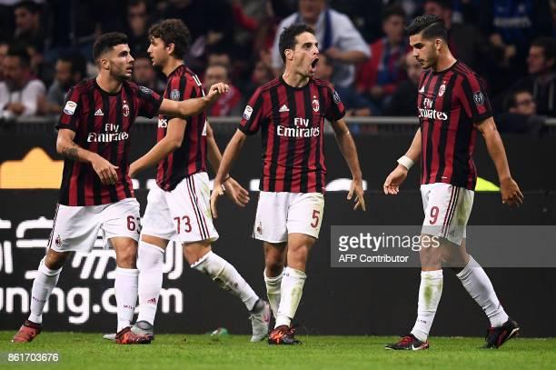 AC Milan's midfielder Giacomo Bonaventura celebrates after scoring during the Italian Serie A football match Inter Milan Vs AC Milan on October 15...