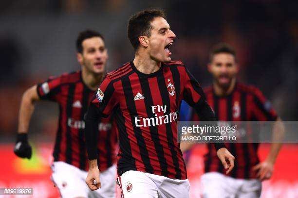 AC Milan's midfielder Giacomo Bonaventura celebrates after scoring during the Italian Serie A football match AC Milan Vs Bologna on December 10 2017...