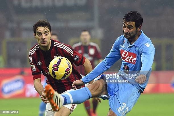 AC Milan's midfielder Giacomo Bonaventura fights for he ball with Napoli's defender from Spain Raul Albiol during the Italian Serie A football match...