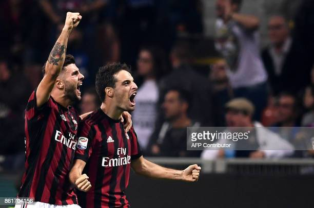 AC Milan's midfielder Giacomo Bonaventura from Italy celebrates after scoring with AC Milan's forward Patrick Cutrone during the Italian Serie A...