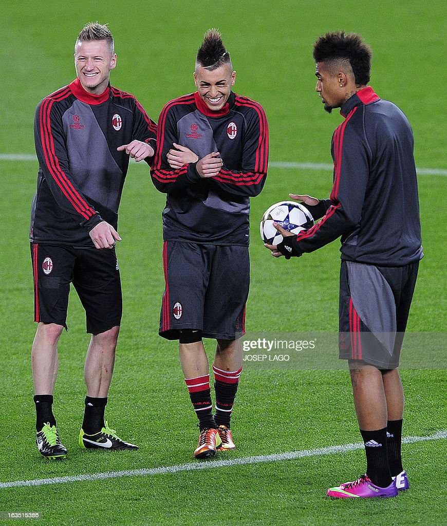 AC Milan's midfielder Ignazio Abate (L), AC Milan's forward Stephan El Shaarawy (C) and AC Milan's Ghanaian defender Prince Kevin Boateng take part in a training session at the Camp Nou stadium in Barcelona on March 11, 2013, on the eve of the UEFA Champions League football match FC Barcelona vs AC Milan.
